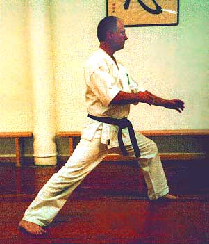 PHOTO OF KARATE-KA IN A LONG FRONT STANCE-HIPS BENT BACKWARDS
