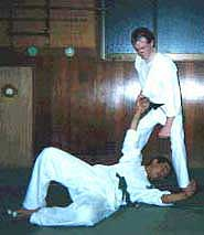 Photograph 4. Turning the hips to the right, throw the opponent down. Possible follow ups can include a well placed strike or kick, a joint lock, or similar technique of subjugation.