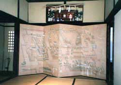 "An old screen depicts a castle town (possibly Matsue) in the Buke Yashiki (""Old Samurai House"")."