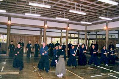 Showing jodo technique at the shrine. Kaminoda Sensei is in the foreground. Photo courtesy of T. Kaminoda.